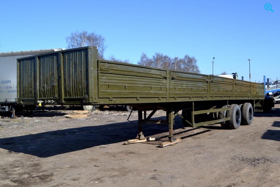 Бортовой полуприцеп МТМ 933004.